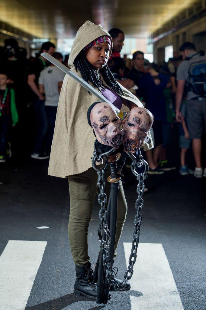 """<p><em>The Walking Dead</em> might be off the air, but Michonne lives on. To recreate the look, opt for a neutral cape or shawl, black boots and some zombies if you can find them! </p><p><a class=""""link rapid-noclick-resp"""" href=""""https://www.amazon.com/Cardigan-Poncho-Cape-Elegant-Sweater/dp/B07664YXZN?tag=syn-yahoo-20&ascsubtag=%5Bartid%7C10055.g.29516206%5Bsrc%7Cyahoo-us"""" rel=""""nofollow noopener"""" target=""""_blank"""" data-ylk=""""slk:SHOP SHAWL"""">SHOP SHAWL</a></p>"""
