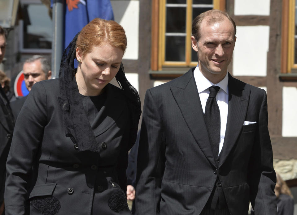 FILE - In this June 3, 2013 file photo Prince Henry Donatus of Hesse, Landgrave of Hesse, and his wife Floria-Franziska walk outside the Lutheran town church of St. John in Kronberg on their way to the funeral service for his father, Moritz Landgrave of Hesse. Prince Henry Donatus will attend Britain's Prince Philip's funeral at St. George's Chapel at Windsor Palace on Saturday. (Arne Dedert/DPA via AP)