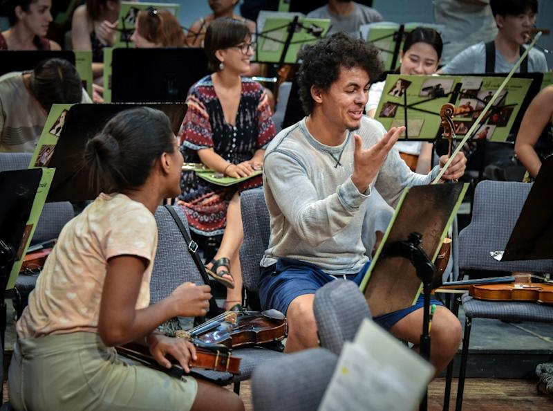 "The Cuban American Youth Orchestra will perform one American piece, ""Billy the Kid"" by Aaron Copland, and two Cuban compositions -- one by Guido Lopez-Gavilan and another by Jorge Amado Molina, a violinist in the orchestra (AFP Photo/ADALBERTO ROQUE)"