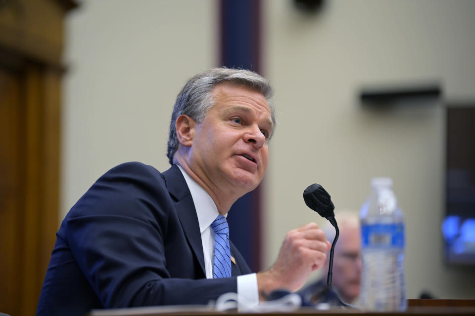 FILE - In this Sept. 17, 2020, file photo Federal Bureau of Investigation Director Christopher Wray testifies before a House Committee on Homeland Security hearing on Capitol Hill Washington. Wray has said the FBI opens a Chinese espionage case every 10 hours. The Justice Department has charged more than 10 cases trade secret thefts tied to China since the China Initiative began. (John McDonnell/The Washington Post via AP, Pool, File)