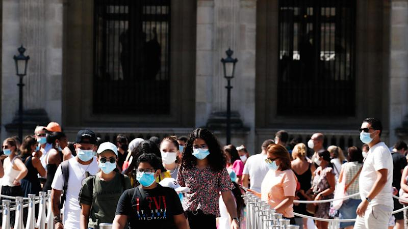 Face masks mandatory in parts of Paris as virus shows signs of resurgence