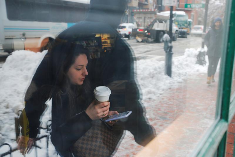 A woman sits in a Starbucks following a winter snow storm in Boston, Massachusetts, U.S., March 4, 2019. REUTERS/Brian Snyder