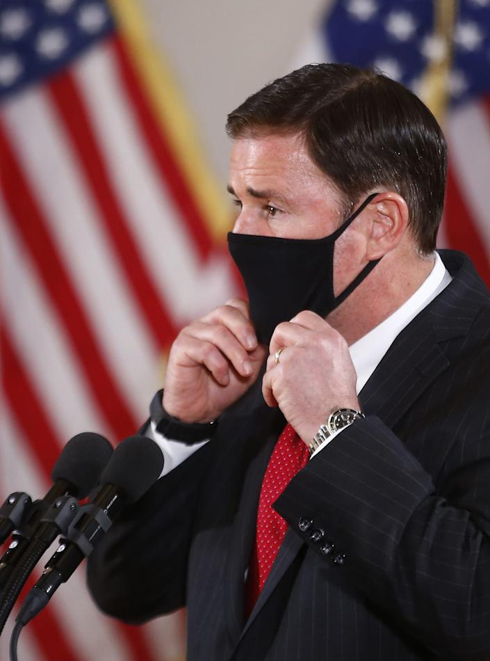 Gov. Doug Ducey leaves a news conference at the University of Arizona College of Medicine-Phoenix in Phoenix on Aug. 31.
