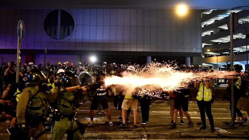 Hong Kong protests descend into violence as demonstrators clash with police
