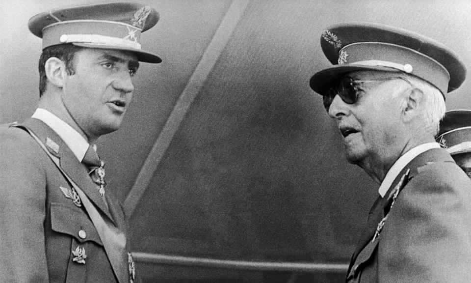 General Francisco Franco with his heir apparent Prince (later King) Juan Carlos at a military ceremony in Madrid in 1972. (Photo by: Universal History Archive/Universal Images Group via Getty Images)