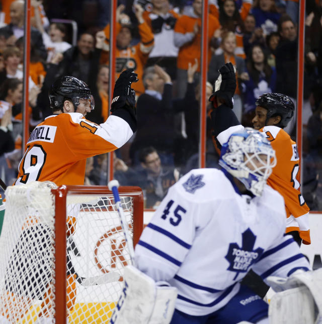 Philadelphia Flyers' Scott Hartnell (19) and Wayne Simmonds (17) celebrate after Hartnell's goal against Toronto Maple Leafs' Jonathan Bernier (45) during the second period of an NHL hockey game, Friday, March 28, 2014, in Philadelphia. (AP Photo/Matt Slocum)