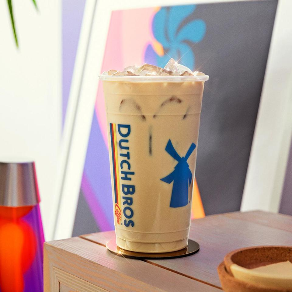 The Iced White Chocolate Lavender Oat Milk Latte takes a Dutch Bros Classic latte to the next level with White Chocolate sauce and Lavender syrup.