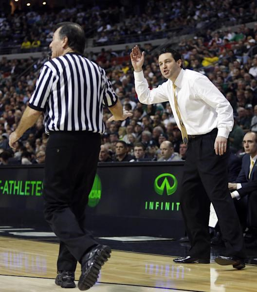 Valparaiso head coach Bryce Drew, right, tries arguing a call with an NCAA official in the first half of a second-round game of the NCAA college basketball tournament Thursday, March 21, 2013, in Auburn Hills, Mich. (AP Photo/Duane Burleson)