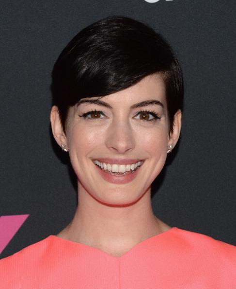 <p>After her role in Les Miserables Anne Hathaway kept her pixie cut for a while and we loved it, she just looked too cute. <i>[Photo: Getty]</i></p>