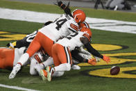 Cleveland Browns strong safety Karl Joseph (42) recovers a fumbled in the end zone for a touchdown during the first half of an NFL wild-card playoff football game against the Pittsburgh Steelers in Pittsburgh, Sunday, Jan. 10, 2021. (AP Photo/Don Wright)