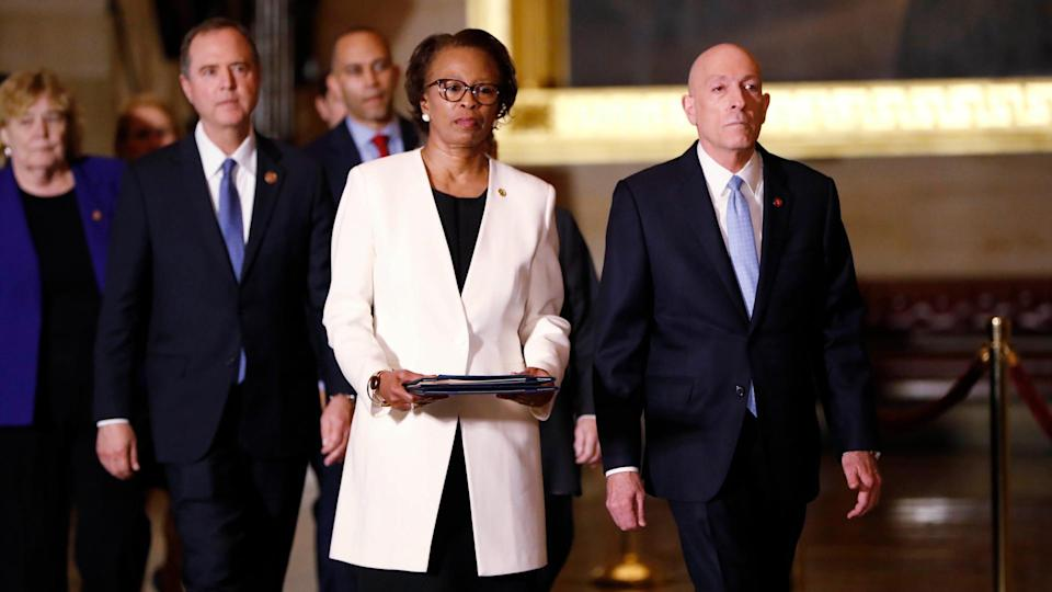 Mandatory Credit: Photo by Julio Cortez/AP/Shutterstock (10527249p)House Sergeant at Arms Paul Irving and Clerk of the House Cheryl Johnson deliver the articles of impeachment against President Donald Trump to Secretary of the Senate Julie Adams on Capitol Hill in Washington, .