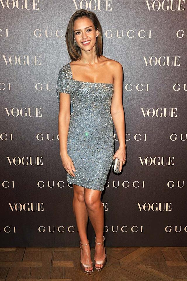 """Wow! Has Jessica Alba ever looked better? We think not. The 29-year-old actress oozed glamour at Paris' Rue Royale reopening in a custom-made Gucci cocktail frock, champagne-colored sandals, and a soft 'do. Pascal Le Segretain/<a href=""""http://www.gettyimages.com/"""" target=""""new"""">GettyImages.com</a> - January 25, 2011"""