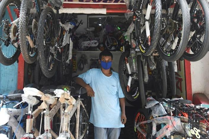 Pedalling to work or school is becoming the new normal for many people in Dhaka (AFP Photo/MUNIR UZ ZAMAN)