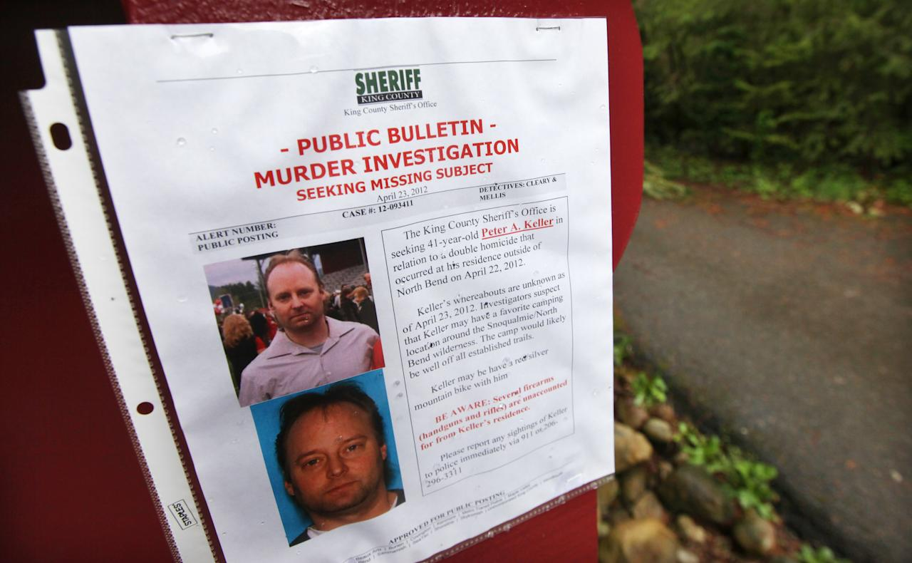 A sign warning of murder suspect Peter Alex Keller is seen at a trailhead several miles from where a gun-toting survivalist is suspected of killing his wife and daughter several days earlier Friday, April 27, 2012, in North Bend, Wash. Keller may be holed up in a self-made fort not far from where Seattle's outer suburbs give way to the vast recreational playground of Cascade Mountains. Police expect more people to hit the nearby trails this weekend, and deputies are warning them to steer clear of Keller if they think they see him. (AP Photo/Elaine Thompson)