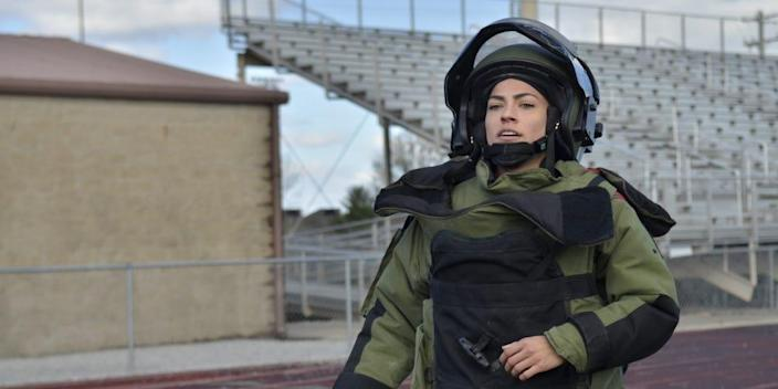 Captain Kaitlyn Hernandez, commander, 717th Ordnance Company, 52nd Ordnance Group (Explosive Ordnance Disposal), trains at Fryar Stadium March 28 in preparation to set the Guinness World Record for the fastest woman to run 1-mile in a bomb suit.