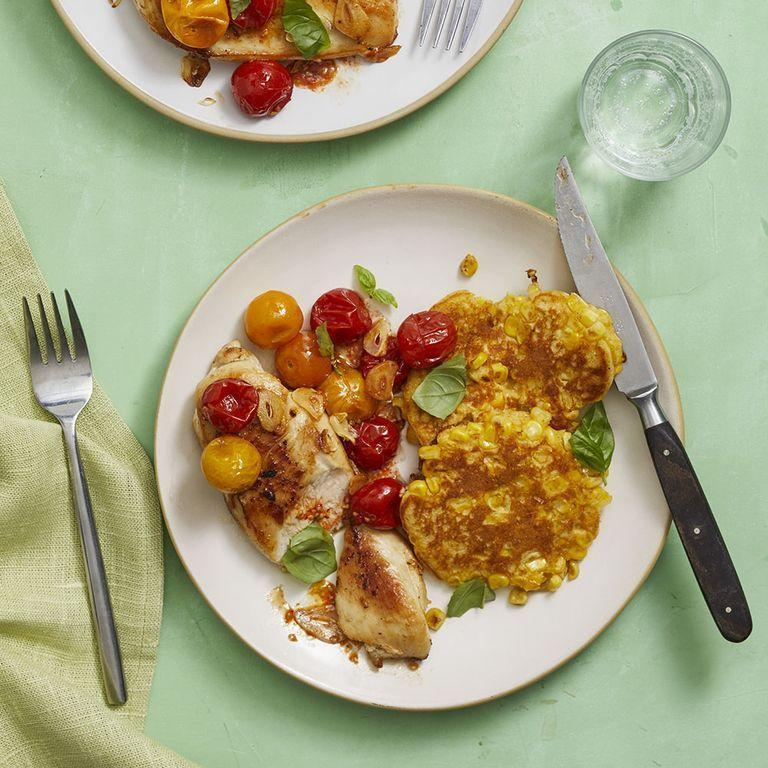 """<p>Take a fresh approach to comfort food with these corn cakes. Pair them with chicken and tomatoes for a summer-fresh meal at any point in the year.</p><p><em><a href=""""https://www.womansday.com/food-recipes/food-drinks/a28353724/seared-chicken-with-tomatoes-and-fresh-corn-cakes-recipe/"""" rel=""""nofollow noopener"""" target=""""_blank"""" data-ylk=""""slk:Get the Seared Chicken with Tomatoes and Fresh Corn Cakes recipe."""" class=""""link rapid-noclick-resp"""">Get the Seared Chicken with Tomatoes and Fresh Corn Cakes recipe.</a></em></p>"""