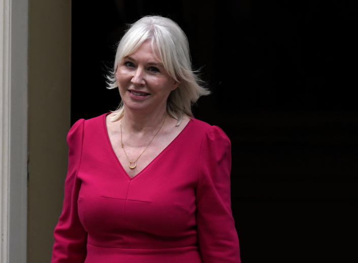 """British MP Nadine Dorries smiles as she leaves 10 Downing Street, in London, Wednesday, Sept. 15, 2021. British Prime Minister Boris Johnson is shaking up his Cabinet as he attempts to move on from a series of political missteps and U-turns. Johnson's office said he would appoint """"a strong and united team to build back better from the pandemic."""" (AP Photo/Alberto Pezzali)"""