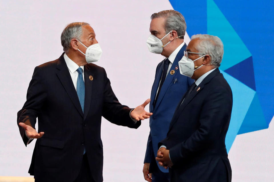 Portugal's President Marcelo Rebelo de Sousa, left, speaks with the president of Dominican Republic, Luis Abinader centre and Portugal's Prime Minister Antonio Costa during the Latin American leaders' summit in Andorra la Valla in Andorra, Tuesday April 20, 2021. Leaders from Latin American countries, Portugal, Spain and Andorra, are set to push for universal access to vaccines and flexible funding for economic recovery at their first summit since the pandemic started. (Alberto Estevez/Pool via AP)