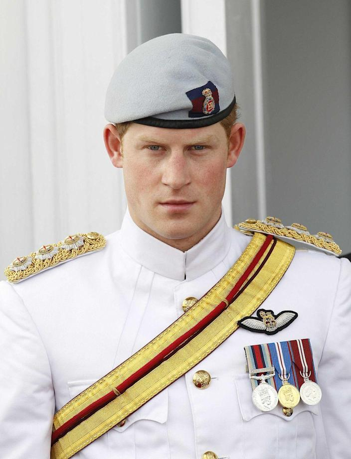 <p>Harry gives an intense look while touring the Bahamas in a full uniform (beret included). The visit was part of Queen Elizabeth II's Diamond Jubilee festivities.</p>