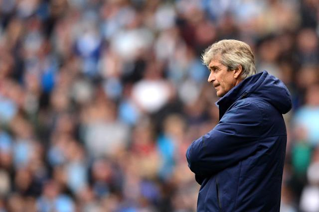 Manchester City's Chilean manager Manuel Pellegrini attends the English Premier League football match between Manchester City and Stoke City at the Etihad Stadium on August 30, 2014 (AFP Photo/Carl Court)