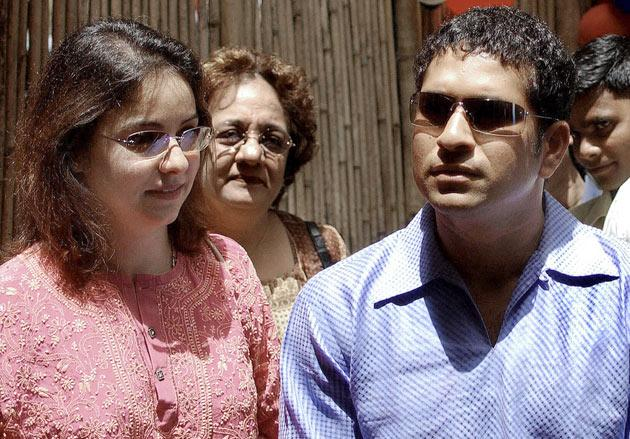 BOMBAY, INDIA:  Indian cricketer Sachin Tendulkar (R) along with his wife Anjali (L) looks around the 'The Fun Factory' which he inaugrated in Bombay, 23 April 2004.  Tendulkar who celebrates his 31st Birthday 24 April, toured around the fun factory which is an activity and play gym for kids between the age of 2 and 6 years. AFP PHOTO/Sebastian D'SOUZA.