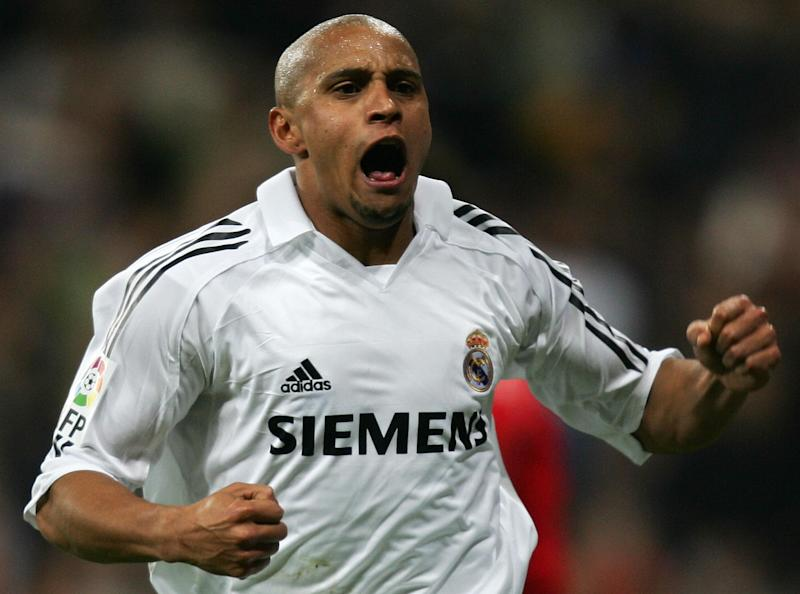 Madrid, SPAIN: Real Madrid's Roberto Carlos reacts after his goal during the Spanish league football match against Zaragoza at the Santiago Bernabeu stadium in Madrid, 06 November 2005. Real won 1-0 AFP PHOTO/PHILIPPE DESMAZES (Photo credit should read PHILIPPE DESMAZES/AFP/Getty Images)