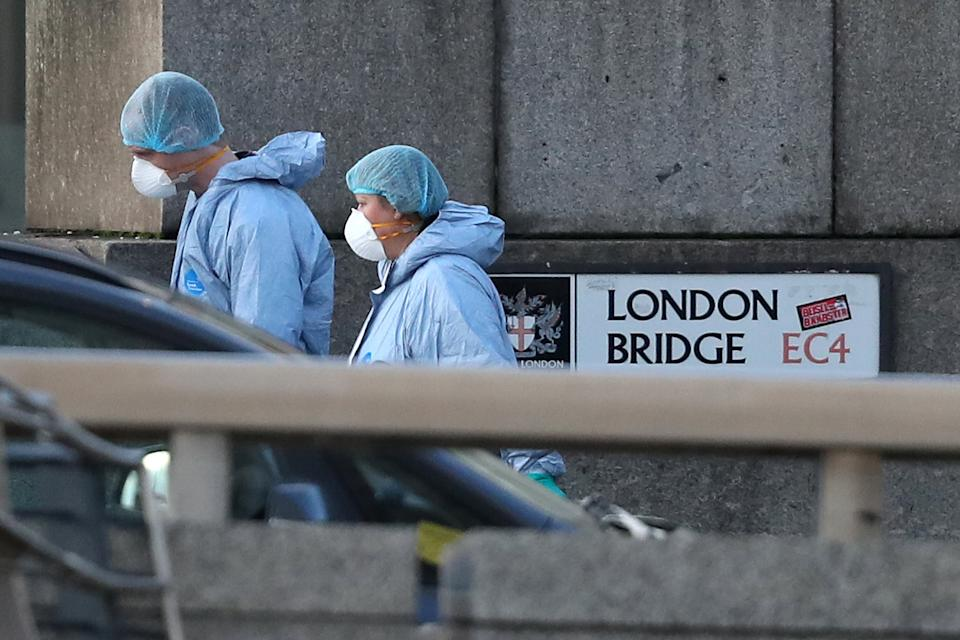 Forensic personnel on London Bridge in central London after a terrorist wearing a fake suicide vest who went on a knife rampage killing two people, was shot dead by police.