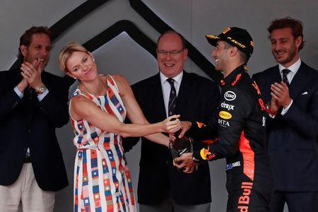 Formula One F1 - Monaco Grand Prix - Circuit de Monaco, Monte Carlo, Monaco - May 27, 2018 Princess Charlene of Monaco holds a bottle of champagne on the podium after Red Bull's Daniel Ricciardo winning the Formula One race, at the Monaco racetrack. Picture taken May 27, 2018. REUTERS/Benoit Tessier