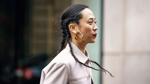 PHOTO: A guest wears earrings, a grey shirt, outside Thom Browne, during Paris Fashion Week Womenswear Fall/Winter 2019/2020, March 3, 2019 in Paris. (Edward Berthelot/Getty Images)