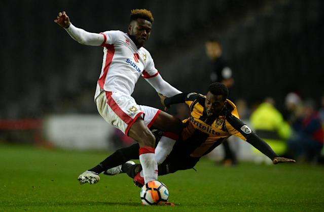 Soccer Football - FA Cup Second Round - Milton Keynes Dons vs Maidstone United - Stadium MK, Milton Keynes, Britain - December 2, 2017 MK Dons' Gboly Ariyibi in action with Maidstone United's Zavon Hines Action Images/Adam Holt