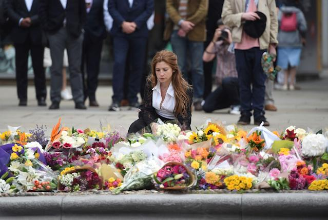 <p>A woman reacts next to flowers left on the south side of London Bridge near Borough Market after an attack left 7 people dead and ozens of injured in London, Britain, June 5, 2017. (Photo: Clodagh Kilcoyne/Reuters) </p>