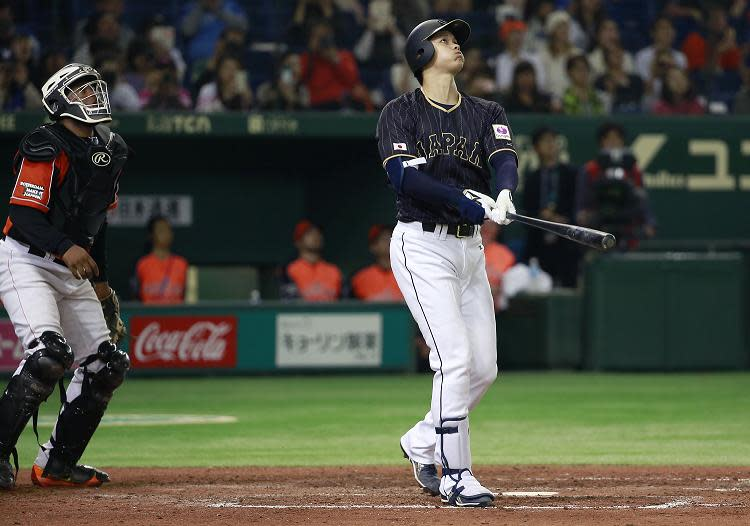 Shohei Otani watches the flight of his ground-rule double during an exhibition game against Netherlands. (AP)