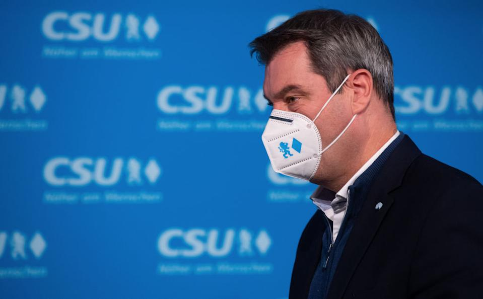 09 November 2020, Bavaria, Munich: Markus Söder (CSU), party chairman and Minister President of Bavaria, is wearing a KN95 mouth-and-nose protector with the CSU symbols lion and rhombus at the party headquarters before his press statement before the start of the CSU executive committee meeting. Photo: Sven Hoppe/dpa (Photo by Sven Hoppe/picture alliance via Getty Images)