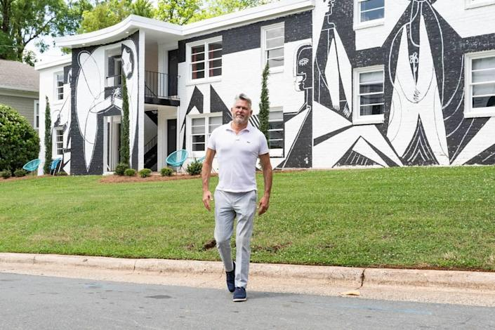James Funderburk (shown) and his husband, Jim Hock, turned 510 Queens Road into an art-forward apartment building, where you can rent a one-bedroom for a night, for a year, or anytime in between. The exterior features a mural by Nico Amortegui.
