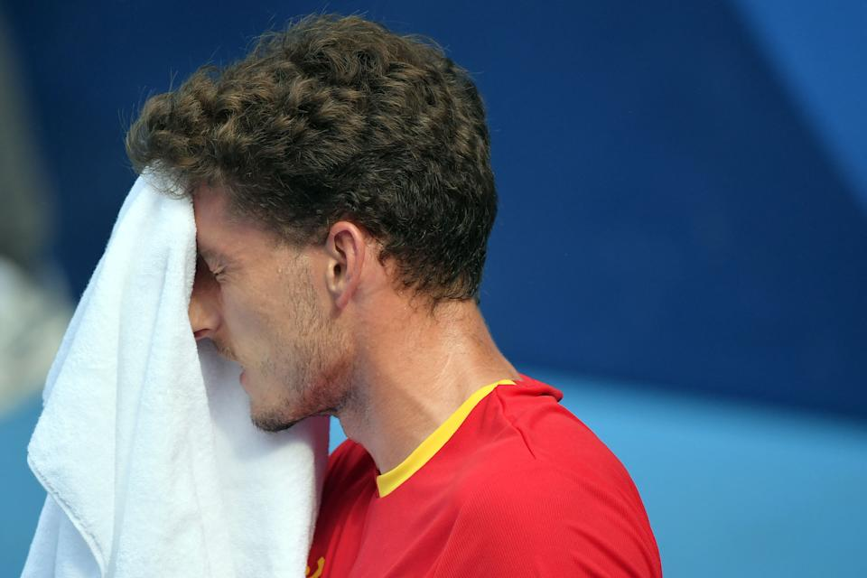 Spain's Pablo Carreno Busta wipes his face as he competes against Russia's Karen Khachanov during their Tokyo 2020 Olympic Games men's singles semifinal tennis match at the Ariake Tennis Park in Tokyo on July 30, 2021. (Photo by Tiziana FABI / AFP) (Photo by TIZIANA FABI/AFP via Getty Images)
