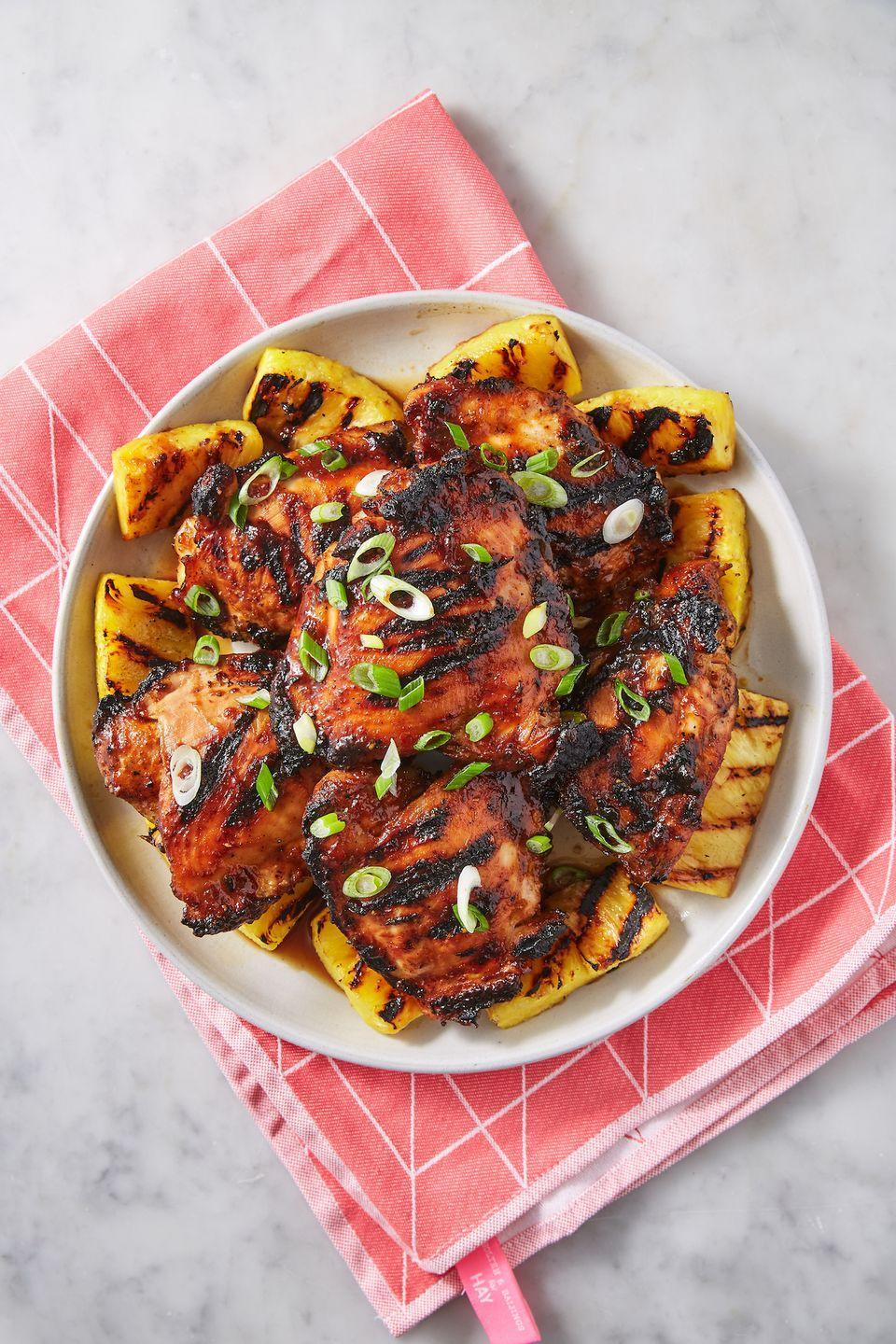 """<p>The grilled pineapple kicks things up a notch. </p><p>Get the recipe from <a href=""""https://www.delish.com/cooking/recipe-ideas/a27972975/huli-huli-chicken-recipe/"""" rel=""""nofollow noopener"""" target=""""_blank"""" data-ylk=""""slk:Delish"""" class=""""link rapid-noclick-resp"""">Delish</a>.</p>"""