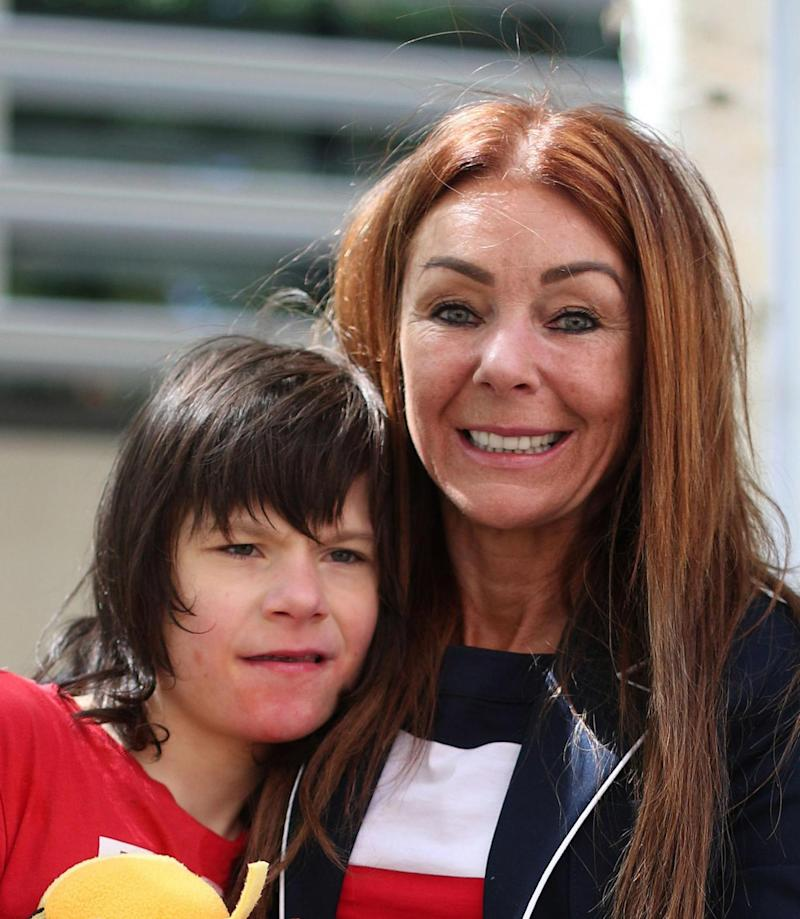 Charlotte with twelve-year-old son Billy Caldwell (PA)