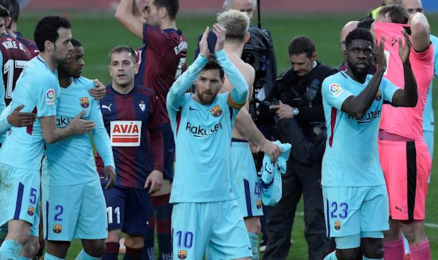 Soccer Football - La Liga Santander - Eibar vs FC Barcelona - Ipurua, Eibar, Spain - February 17, 2018 Barcelona's Lionel Messi and Samuel Umtiti applaud the fans at the end of the match REUTERS/Vincent West