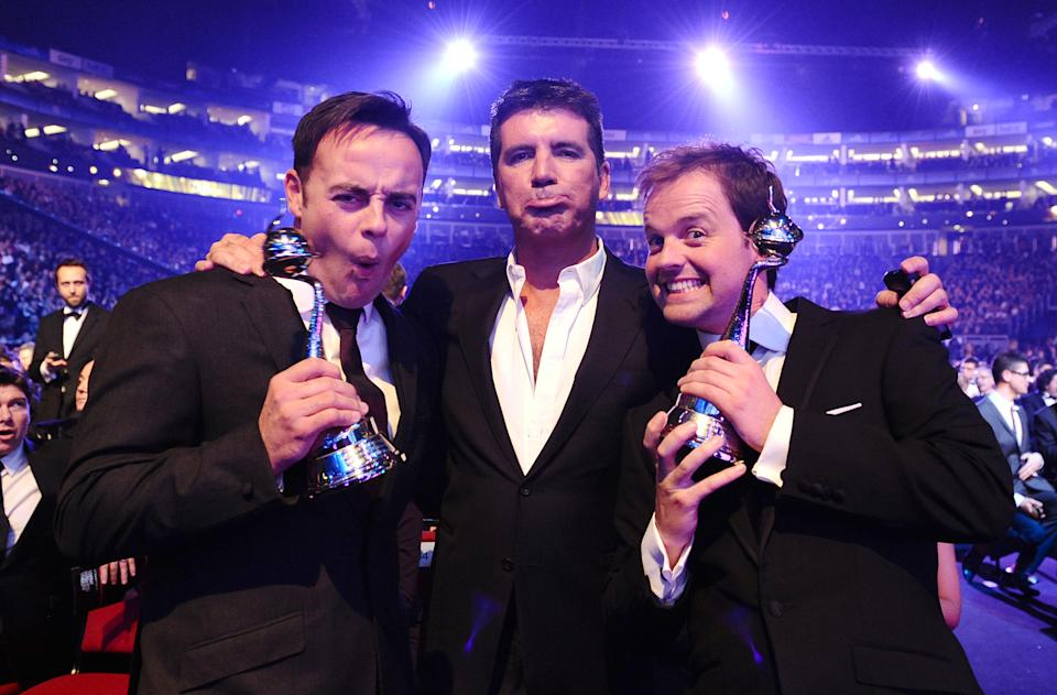 Anthony McPartlin (left), Simon Cowell and Declan Donnelly during the National Television Awards 2010, at the 02 Arena, London.   (Photo by Ian West/PA Images via Getty Images)