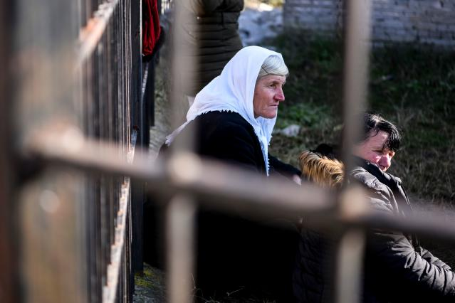 Relatives of people living at a collapsed building in Thumane. (Photo: Armend NimaniI/AFP via Getty Images)