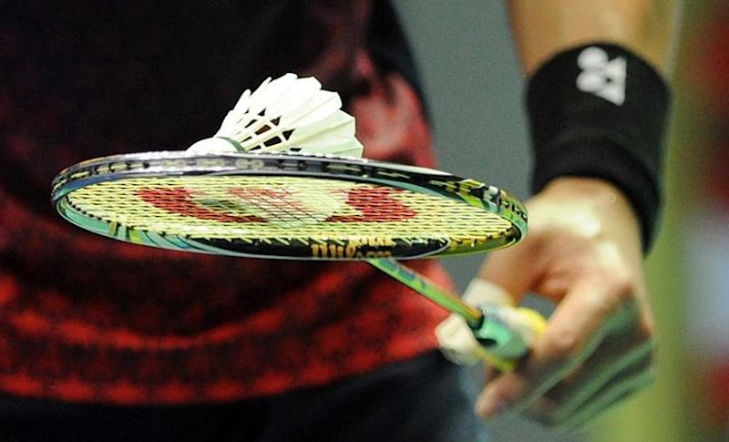 Sho Sasaki of Japan carries a shuttlecock on his racquet in his match against Kevin Cordon of Guatalmala in their first round at the China Open badminton tournament in Shanghai on November 23, 2011. AFP PHOTO/Peter PARKS (Photo by PETER PARKS / AFP)