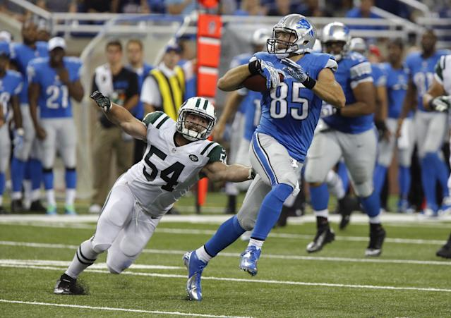 Detroit Lions tight end Tony Scheffler (85) pulls away from New York Jets linebacker Nick Bellore (54) during the second quarter of an NFL preseason football game at Ford Field in Detroit, Friday, Aug. 9, 2013. (AP Photo/Duane Burleson)