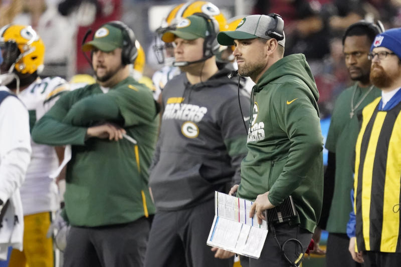 Green Bay Packers head coach Matt LaFleur, center right, watches during the first half of the NFL NFC Championship football game against the San Francisco 49ers Sunday, Jan. 19, 2020, in Santa Clara, Calif. (AP Photo/Tony Avelar)