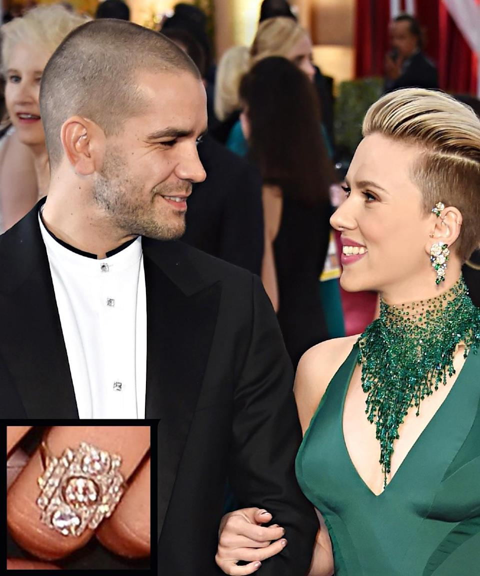 """<p>Actress Scarlett Johansson got engaged to French journalist Romain Dauriac in 2013. The actress's <a rel=""""nofollow noopener"""" href=""""http://www.instyle.com/news/scarlett-johanssons-engagement-ring-big-photo-big-rock"""" target=""""_blank"""" data-ylk=""""slk:ring"""" class=""""link rapid-noclick-resp"""">ring</a> is a unique, large rectangular Art Deco piece with three round diamonds. The couple wed in October 2014.</p>"""