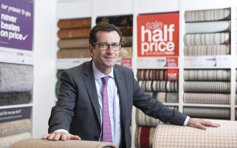 "Carpetright boss Wilf Walsh warned ""consumer confidence remained fragile"""