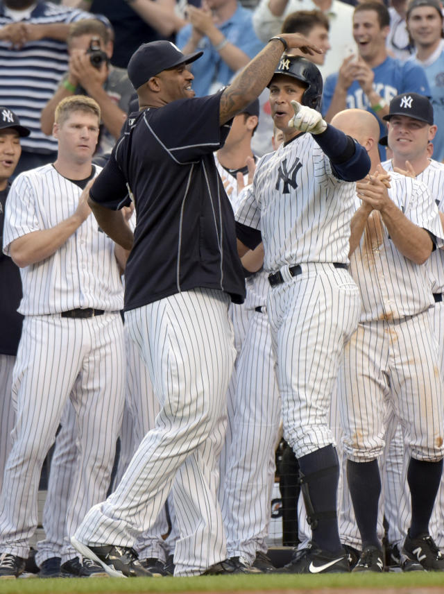 New York Yankees' Alex Rodriguez, center right, celebrates with CC Sabathia after Rodriguez hit a home run during the first inning of a baseball game against the Detroit Tigers on Friday, June 19, 2015, at Yankee Stadium in New York. The home run was his 3,000th career hit. (AP Photo/Bill Kostroun)