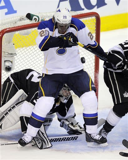 St. Louis Blues left wing Alexander Steen, top, tries to control the airborne puck as Los Angeles Kings goalie Jonathan Quick sits in goal during the second period in Game 3 of an NHL hockey Stanley Cup second-round playoff series, Thursday, May 3, 2012, in Los Angeles. (AP Photo/Mark J. Terrill)