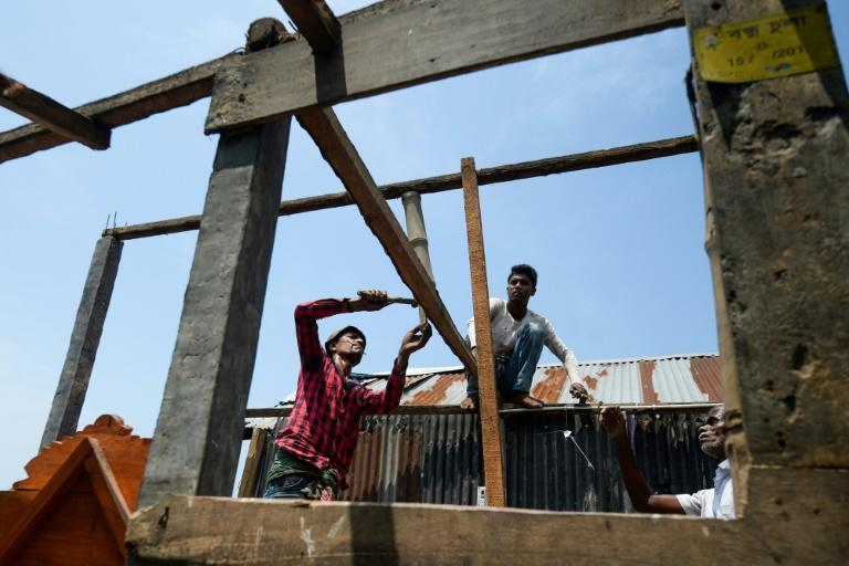 Villagers in Satkhira in Bangladesh set about repairing their homes damaged by cyclone Amphan