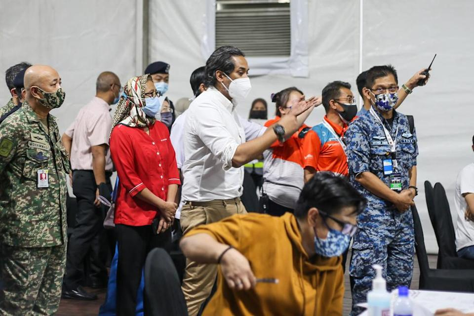 Minister of Science Technology and Innovation Khairy Jamaluddin visits the Covid-19 vaccination centre in Bukit Jalil June 21, 2021. — Picture by Ahmad Zamzahuri