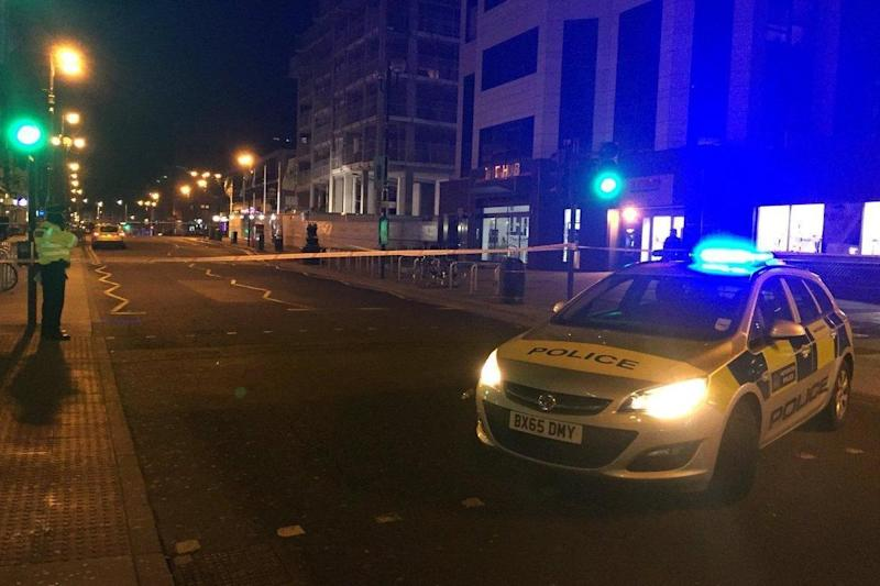 Crime scene: police erected a cordon outside Harrow-on-the-hill station: Jassim Al-Kanani